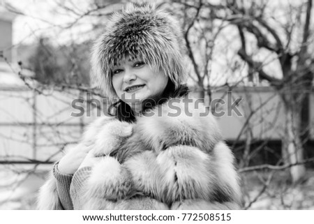 30c0c5a8629c6 Cute and beautiful mature plus size woman in fur coat on winter background.  Life after
