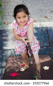 Cute beautiful smiling little girl on a playground
