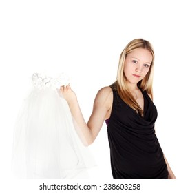 cute beautiful young girl holding the wedding veil in her hand