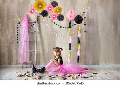 Cute beautifull girl lady posing in fancy violet dress skirt with number seven celebrating her birthday day with fun and joyful in studio scene