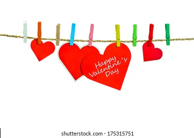 Cute big red heart hanging on the clothesline. On white  background