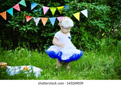 Cute birthday girl on party background