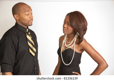 Cute black couple in affectionate talk with smiles of joy