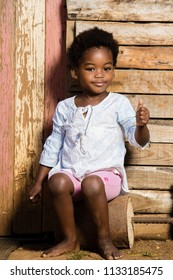 Cute black girl looking into the camera while showing a thumbs up with a grinn on her face