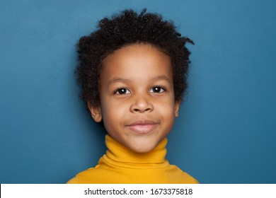 Cute black kid face on blue background