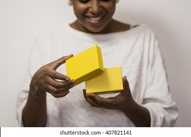 Cute black woman receiving a gift.