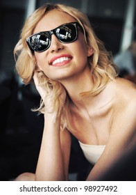 Cute blond beauty wearing sunglasses