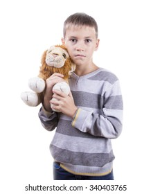 Cute blond boy holding a stuffed animal. Isolated on white background.