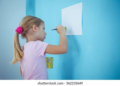 Cute blond girl painting