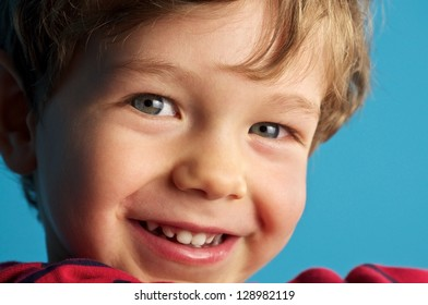 Cute blond smiling child
