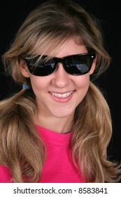 Cute blond with sunglasses, with a happy smile