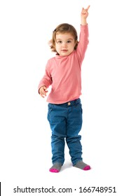 Cute blonde baby pointing up over white background