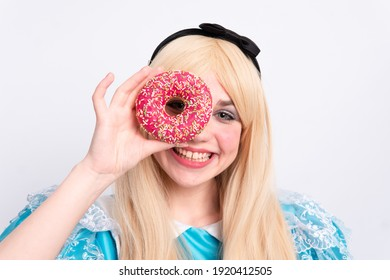 Cute blonde girl holding donuts
