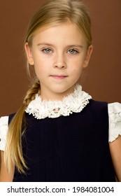 Cute blonde girl in school uniform