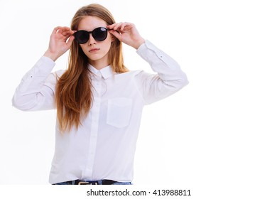 Cute blonde keeps the sunglasses in the Studio on a white background. Insulation.