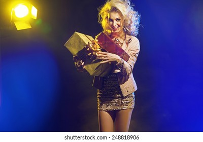 Cute blonde lady holding a gift