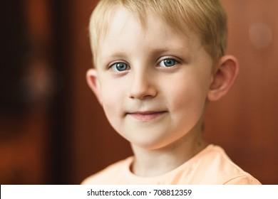 Cute blonde little boy portrait, happy school boy
