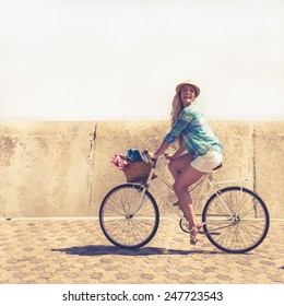 Cute blonde on a bike ride on a sunny day