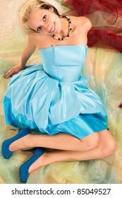 cute blonde posing  in a blue dress