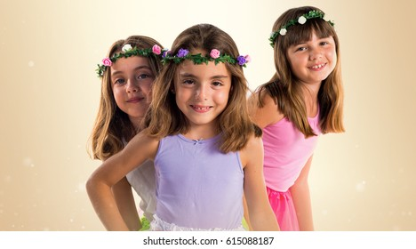 Cute blonde sisters with crowns of flowers