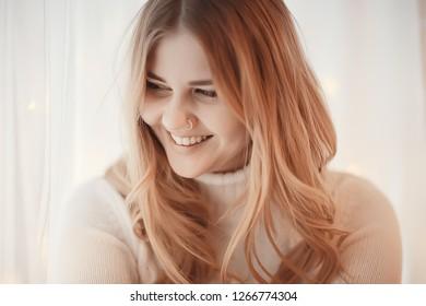 cute blonde sweater portrait / winter look, portrait of beautiful model with long hair in cold season