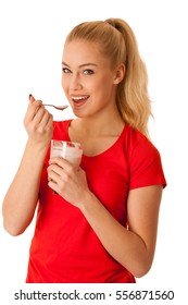 Cute blonde woman eating fruit yogurt isolated over white background