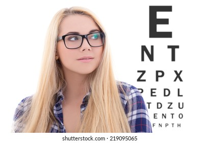 cute blondie girl in eyeglasses on the background of eye test chart
