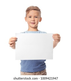 Cute boy with blank sheet of paper for advertising on white background