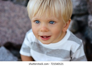 Cute boy with blond hair and blue eyes