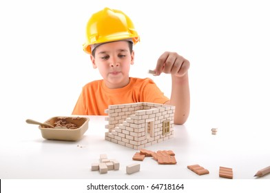 Cute boy building house isolated on white - a series of BUILDING A HOUSE  images.