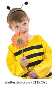 cute boy in bumble bee costume holding red flower