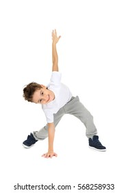 Cute boy dancing on white background