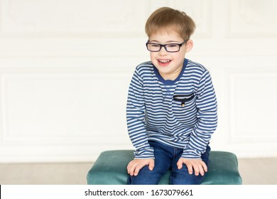 Cute boy with down syndrome with glasses