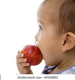 cute boy eating an apple, isolated on white background