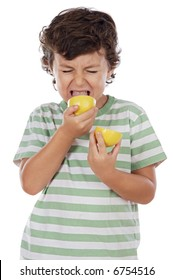 Cute boy eating lemon over a white background