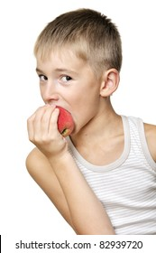 cute boy eating red apple isolated on a white background