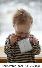 cute boy enjoing hot chocolate