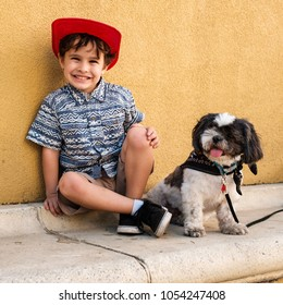 Cute boy enjoying the outdoors with his dog.