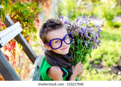 Cute boy with flowers in a beautiful sunny day