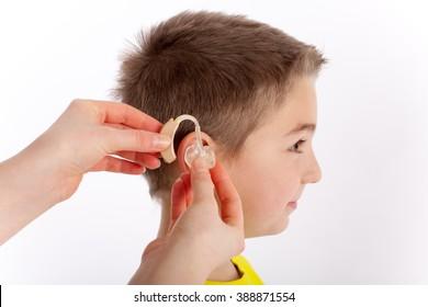 Cute boy getting his first hearing aid