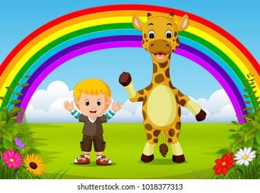 cute boy and giraffe at park with rainbow scene