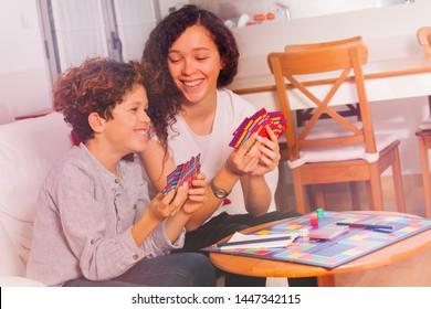 Cute boy and girl having fun playing tabletop game