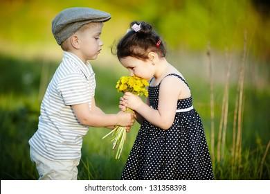 cute boy and girl on summer field