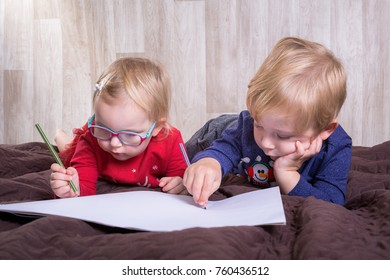 Cute boy and girl twins writting letter for Santa