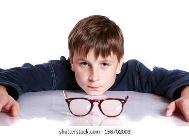 cute boy with glasses and low vision