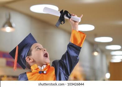 Cute boy in graduation uniform