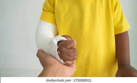 Cute boy hand bone broken from accident with arm splint