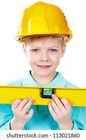 Cute boy in hardhat holding a level and looking at camera
