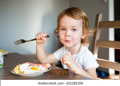 Cute boy having Breakfast