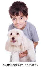 A cute boy with his white dog isolated on white background.